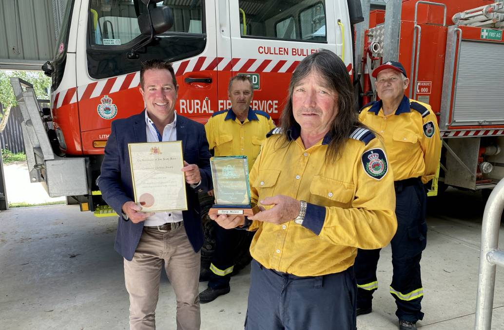 COMMUNITY SERVICE AWARD: Cullen Bullen RFS Captain Darcy McCann receives his Community Service Award from Member for Bathurst Paul Toole. Also pictured are John McCann and Les Ayres, far right. Photo: SUPPLIED