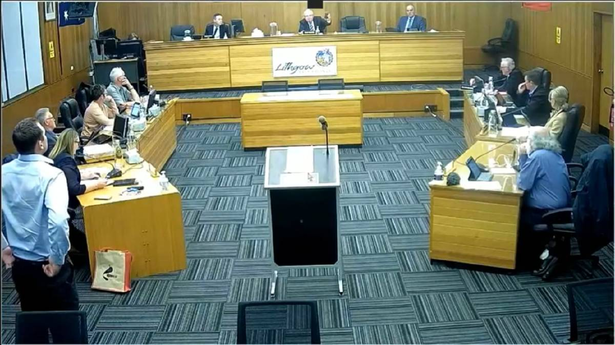 COUNCIL: Mayor Ray Thompson holds up a jar of dirty water from Wallerawang for the councillors to see. Photo: Lithgow City Council October live stream.
