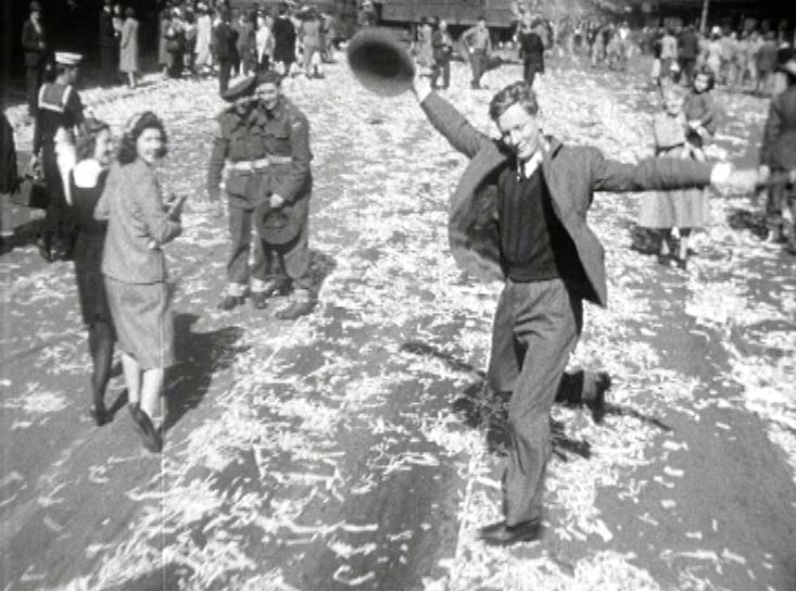 DANCING MAN: This now-famous still from a newsreel features an anonymous man dancing on the street in Sydney, Australia, after the end of WWII. It was featured on a 2005 commemorative $1 coin.