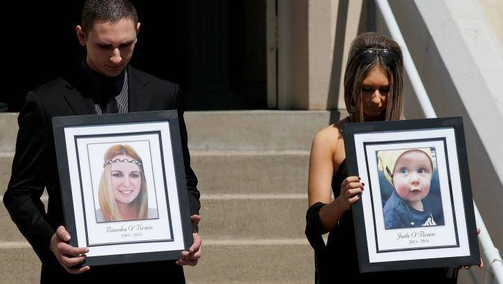 Killed in the blast: relatives of Bianka and Jude O'Brien carry their photographs at their funeral. Photo: Daniel Munoz