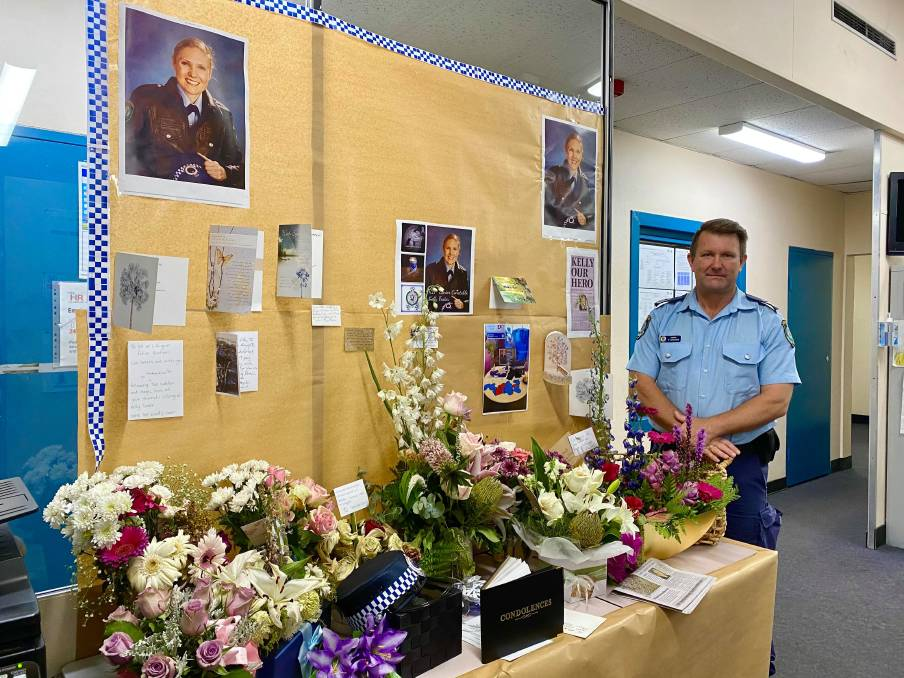 KELLY OUR HERO: Lithgow Police Sergeant Darryl Goodwin with the station's tribute for Sen Const Kelly Foster. Photo: ALANNA TOMAZIN.
